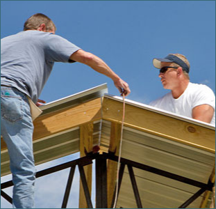 Two Men Working on a Building Project