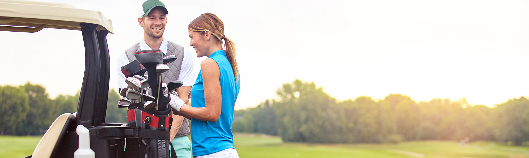 Man and Woman Talking Together on the Golf Course